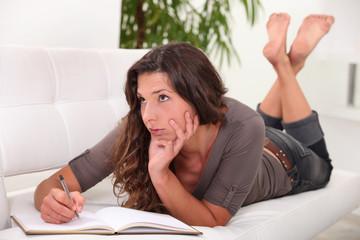 Woman writing in her diary