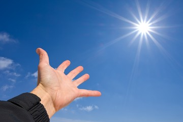 people hand pointing to a sun