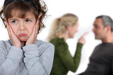 Little girl listening to parents argue