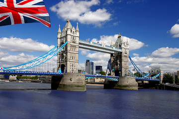 Fototapete - Tower Bridge with flag of England in London