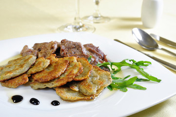 Lamb medallions with homemade potato pancakes, Czech cuisine