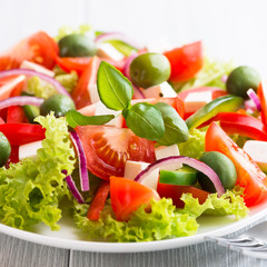 Obraz Vegetable Salad with Feta Cheese and Green Olives - fototapety do salonu