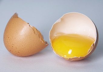 cracked egg, white background side view