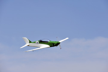ultralight airplane flying in the sky