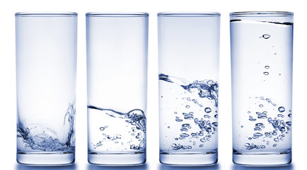 four glasses filled with water