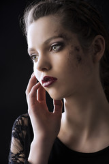 fashion low key portrait, her hand is near the face