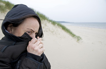 woman shivering on beach
