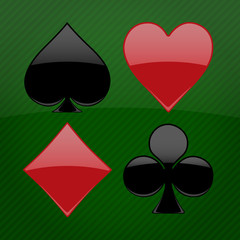 Illustration of the four glossy card suits on background