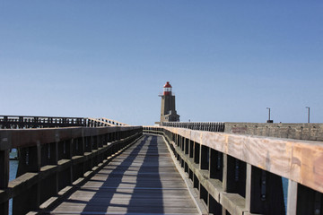 wooden pier and  lighthouse of the port of fécamps in normandy