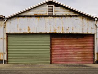 Grungy rusted corrugated iron garage doors