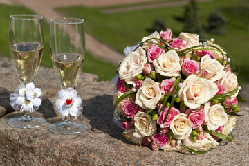 Wedding Bouquet Beside Tall Wine Glasses
