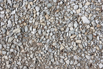 Background with crushed stone. Mountain road.