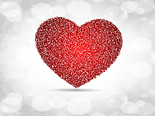 Sparkling red heart shape on grey abstract background.