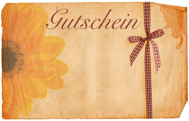 old paper voucher with flower