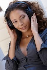 Sexy ethnic woman with headphones