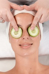 Natural beauty treatment with cucumber on eyes