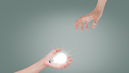 Women hand with lamp bulb