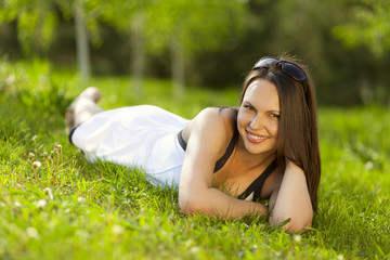 Beautiful young woman relaxing in a park