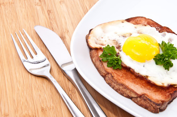 Meat loaf with fried egg on a plate