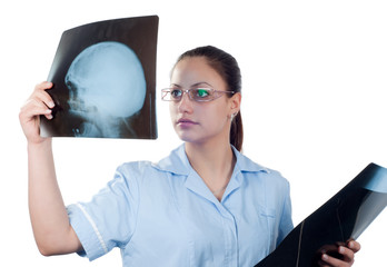 Young female doctor looking at x-ray picture of patients skull