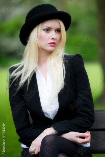 Beautiful young business woman in bowler hat
