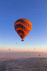 Balloons in the sky over Cappadocia at sunrise