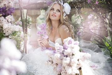 portrait of a bride with a bouquet of lilacs