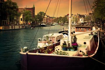 Amsterdam. Romantic canal, boats.