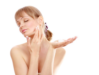 A beautiful woman applying a cream on face
