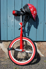 Uni-cycle and red safety helmet with flowers