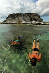 Wall Mural - Two people snorkeling on vacation