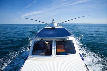 big game fishing boat on calm sea