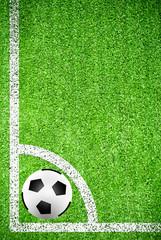 Soccer ball on artificial grass field texture
