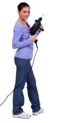 Woman holding a screw gun
