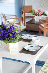 dining table set with dish and flower