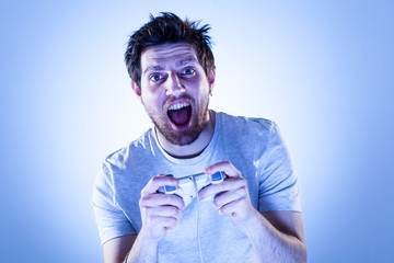 Amazed Man Playing Videogames with Gamepad