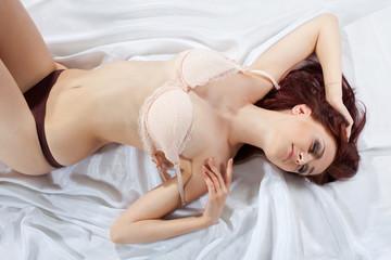 beauty sexy young girl on silk undress bra