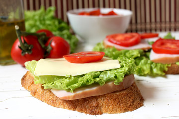 sandwich with tomato, cheese, bacon and salad