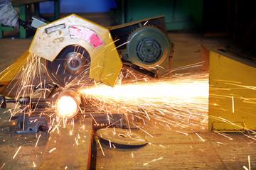 Industrial worker cutting ,fiber glass make a spark