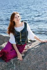 Medieval woman near the sea
