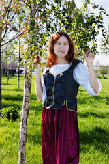 Medieval woman near the birch