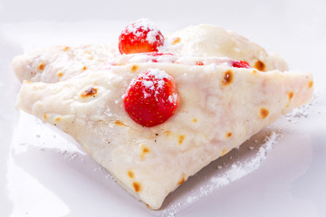 Mascarpone cheese pancakes with fresh strawberries