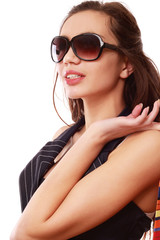A young beautiful woman wearing sunglasses, isolated on white