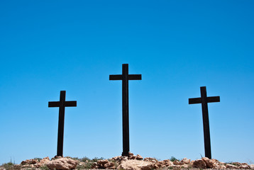 Three crosses on blue sky