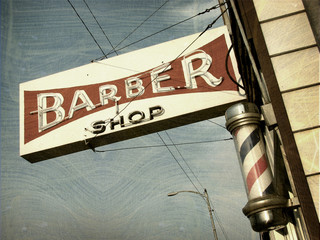 aged and worn vintage photo of barber shop sign