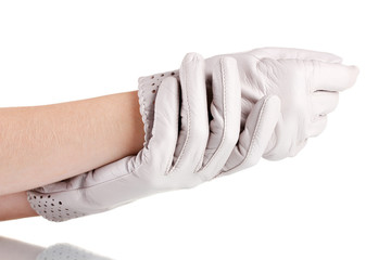 women's hands in gray leather gloves isolated on white