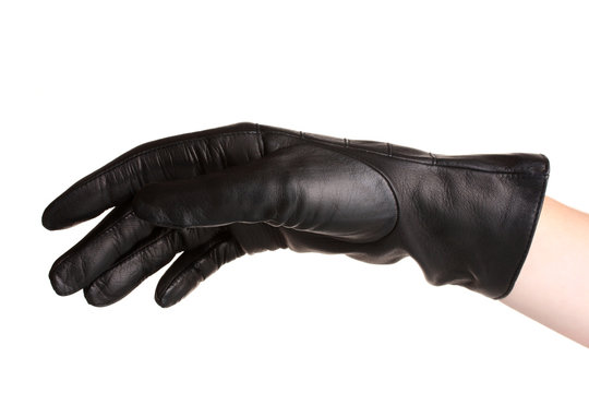women hand in black leather glove isolated on white