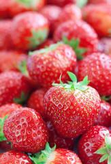 fresh ripe strawberries closeup. food background .