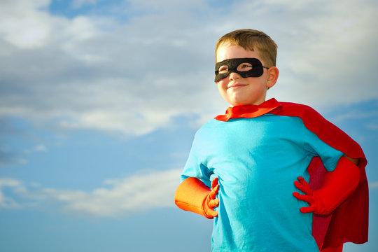 Child pretending to be a superhero