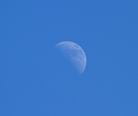 Moon Against Blue Sky